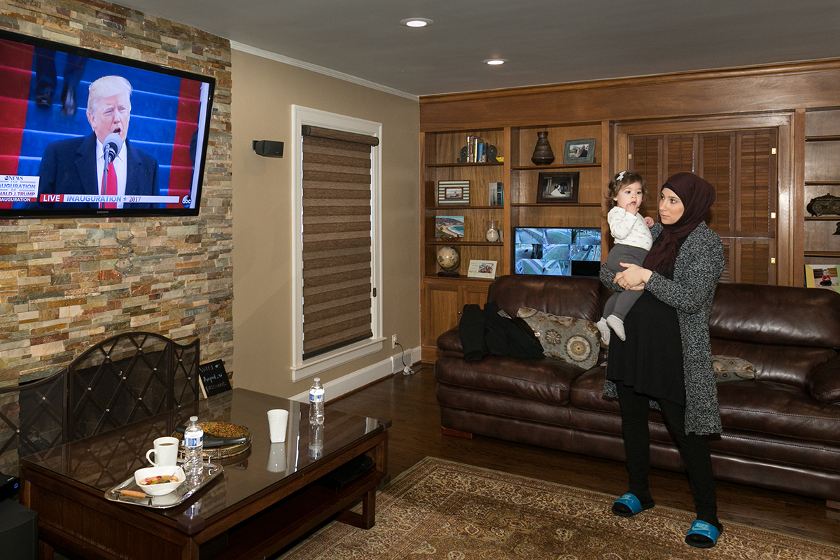 Mariam Charara watches the inauguration at her home in Dearborn