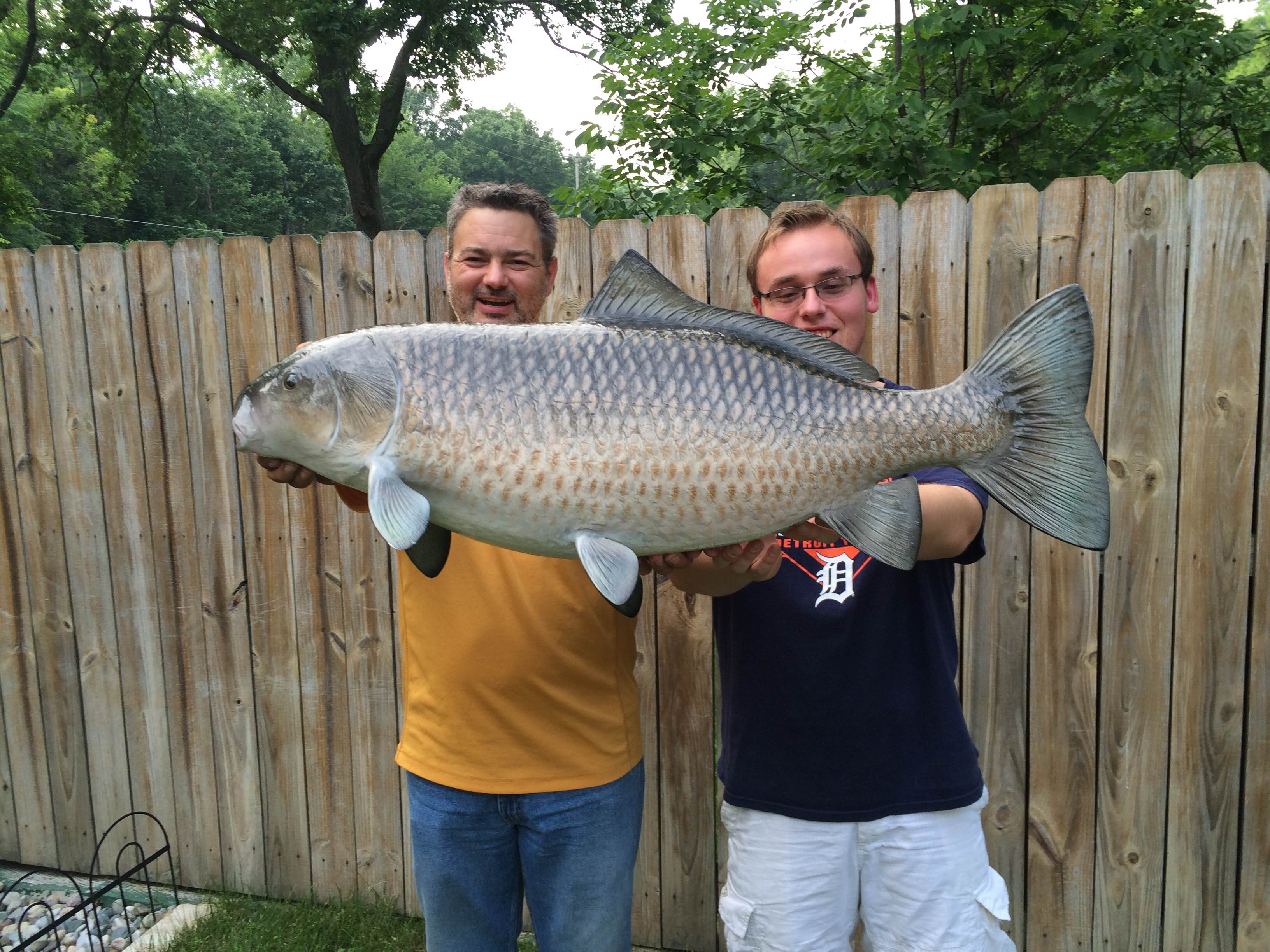 e03c8ea3e7 Tony and Josh Witherell hold a monster buffalo fish they caught in west  Michigan. They