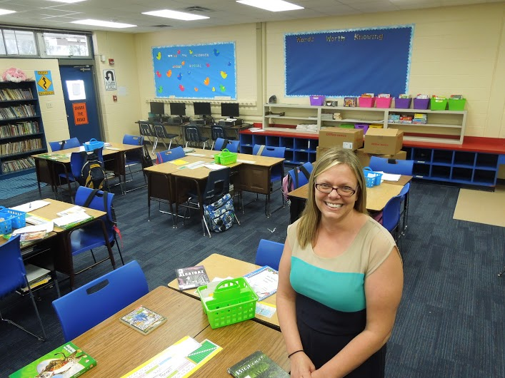 Leslie Moore sitting in her fourth-grade classroom