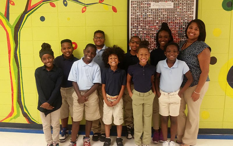 Teacher Carmen Little and students in her third-grade classroom