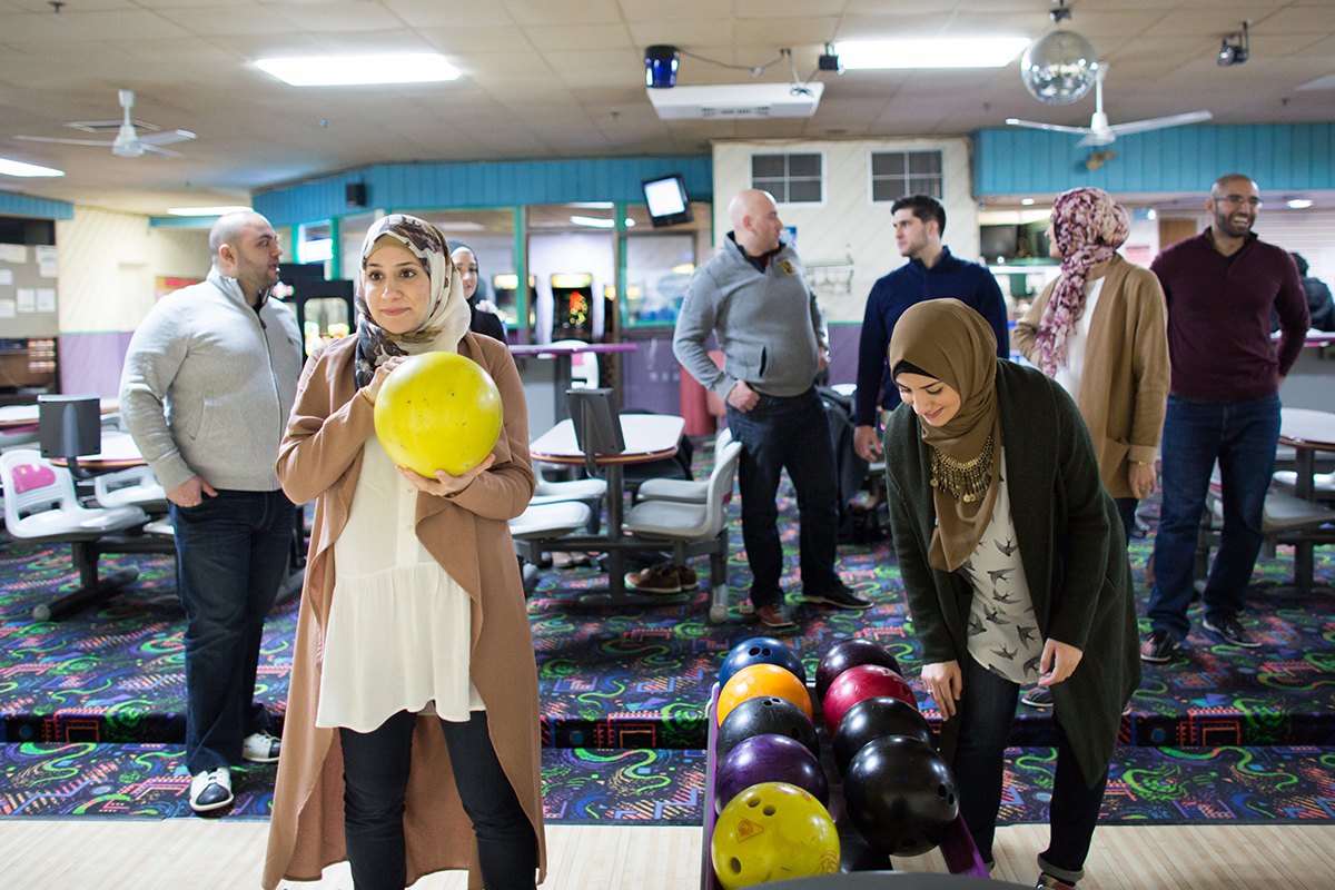 Mariam Charara, left, and her sister Leila Dahoui, hang out at Cherry Hill Lanes in Dearborn Heights