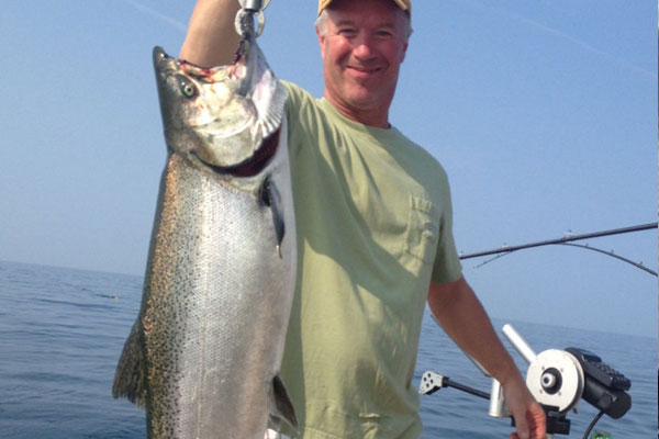 Bob Oswald holding up his king salmon from a hook