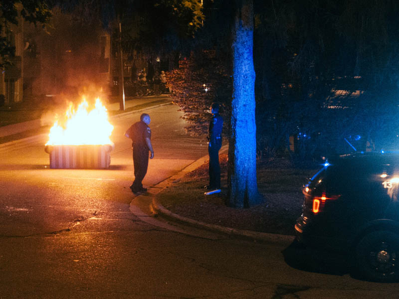 A couch burning in the street