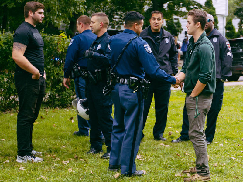 MSU police talking with partygoers