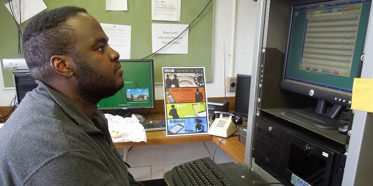 Ramone Williams looking an audio clips on a computer screen