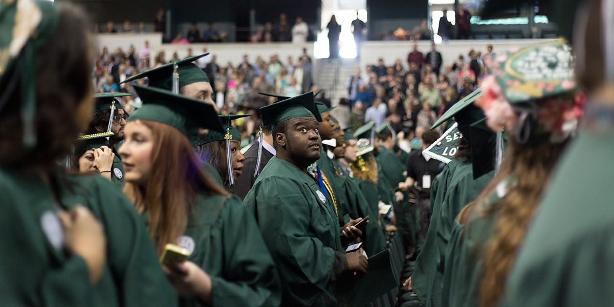 Ramone Williams looking up toward the audience at his college graduation