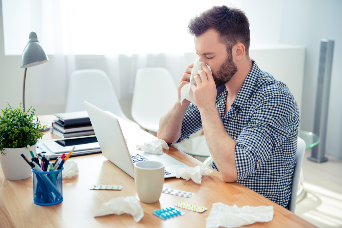 Sick worker in office