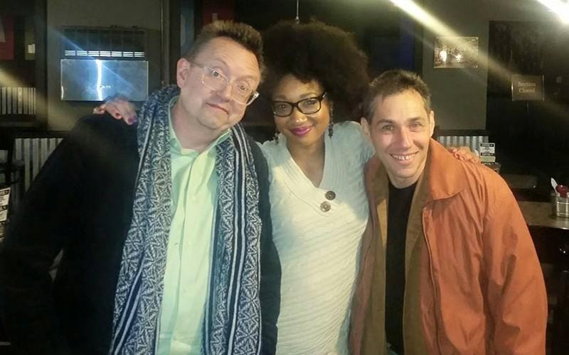 A trio of comedians posing for a photo