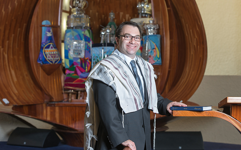 Rabbi Greg Weisman posing for a photo inside his temple