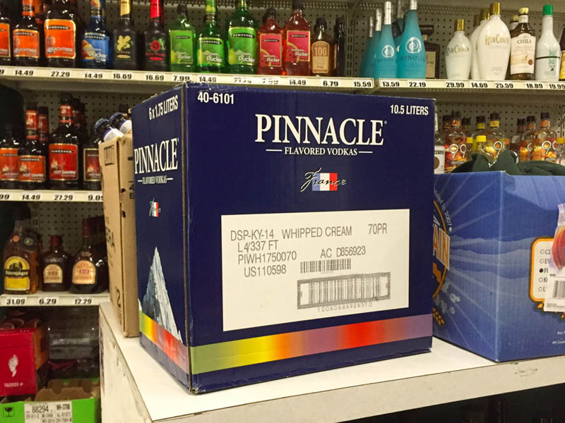 A box of Pinnacle flavored vodkas on the corner of a shop counter