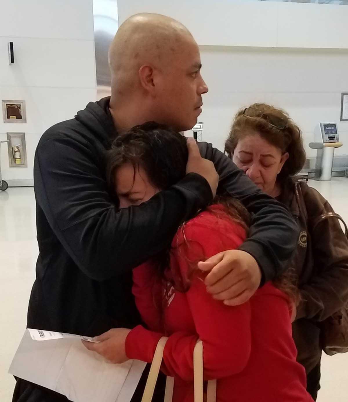 Maria hugs her husband