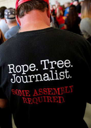 "The back of a t-shirt saying ""Rope. Tree. Journalist. Some Assembly Required."""
