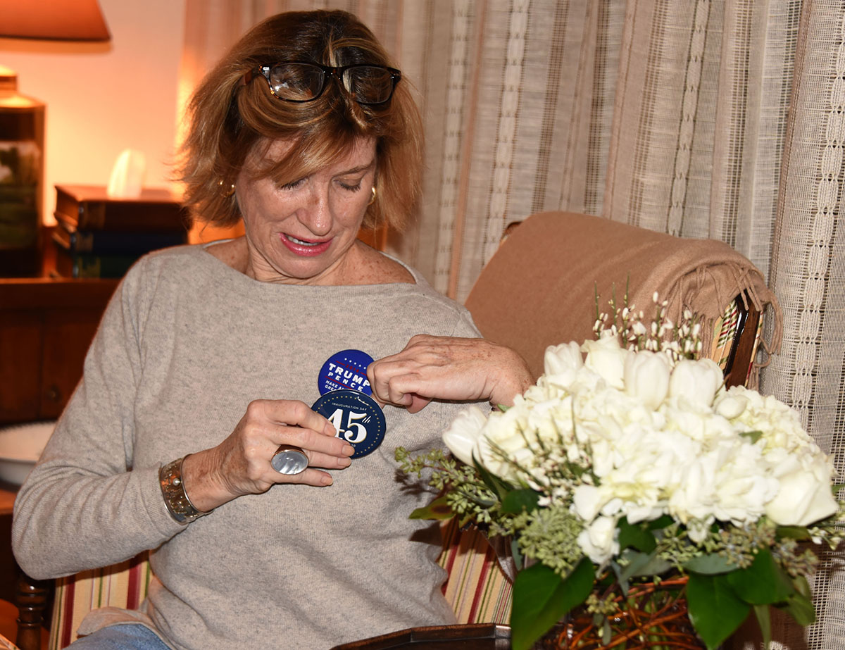 Cindy Schaffer putting on a Trump button.