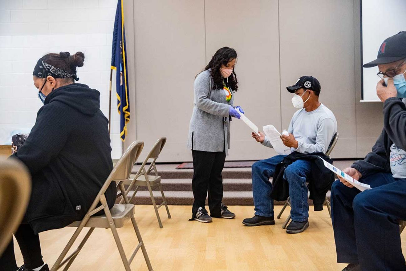 Claudia Pohlen of the Hispanic Center of Western Michigan passes out information about Michigan's redistricting process during a COVID-19 vaccination clinic this month in Wyoming.