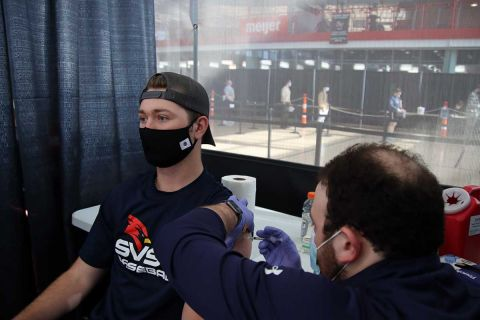 Saginaw Valley State University student Matt Montroy gets a COVID-19 vaccine shot on campus