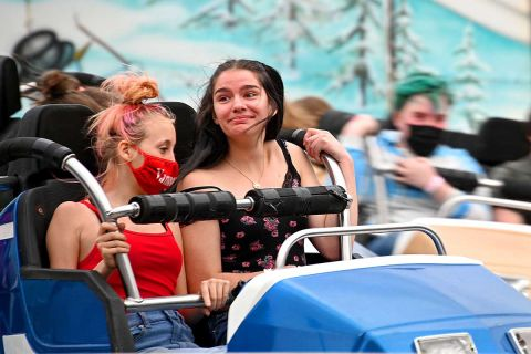 Teens react to a carnival ride at the Durand Railroad Days Festival.