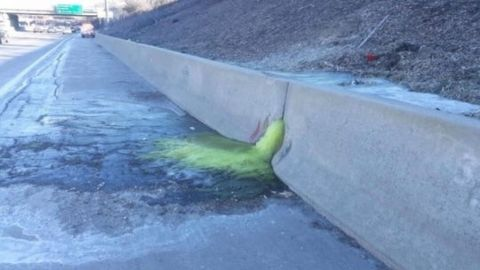 Green ooze on Michigan freeway prompts calls for tougher polluter pay laws