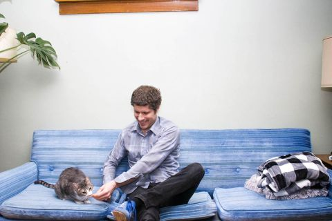 Reporter Tom Perkins and his cat, Ling Ling