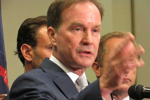 Schuette goes to bat for ExxonMobil; brief calls climate change 'unsettled science'