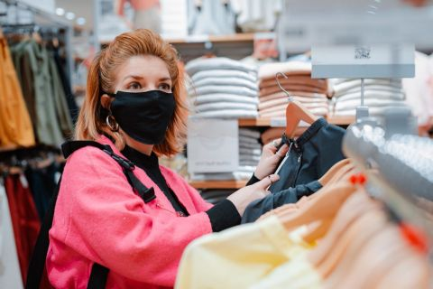Retail worker in a mask