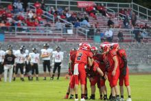 Small-town Michigan high schools dump traditional football