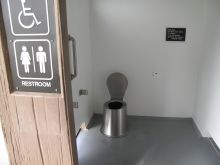 Bittersweet relief in city's doorless, unisex restrooms